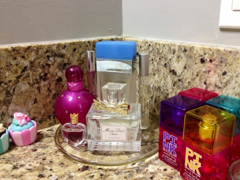 Used a candle stand to function as a tray for perfumes.